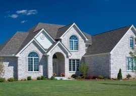 Beautiful White Brick Home With Fantastic Installed Windows.