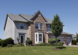Suburban home with brown brick and gray sidiing
